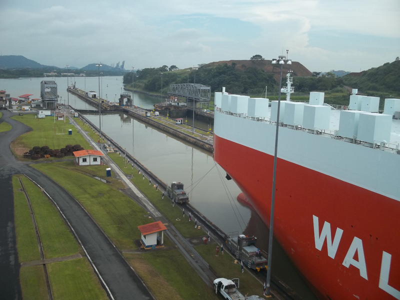 You can see the little tugboat trains pulling it through the lock.