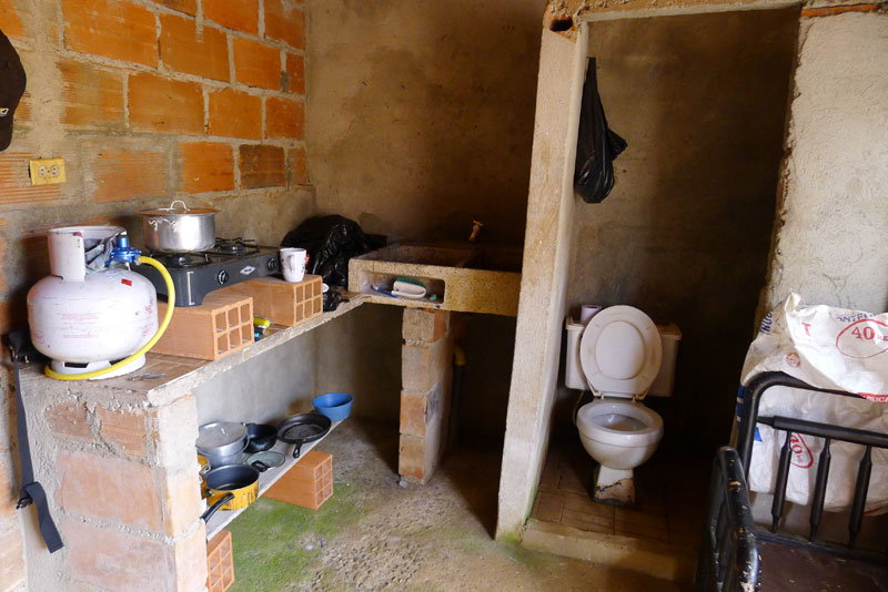 Upgraded kitchen: a stove and cooking pots that Marcos recently acquired for a man in town