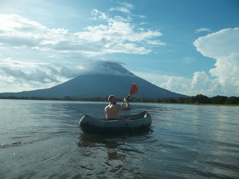kayaking in front of volcano