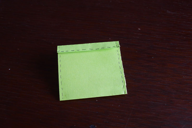Rotate with flap side pointed up. Sew along side edges.