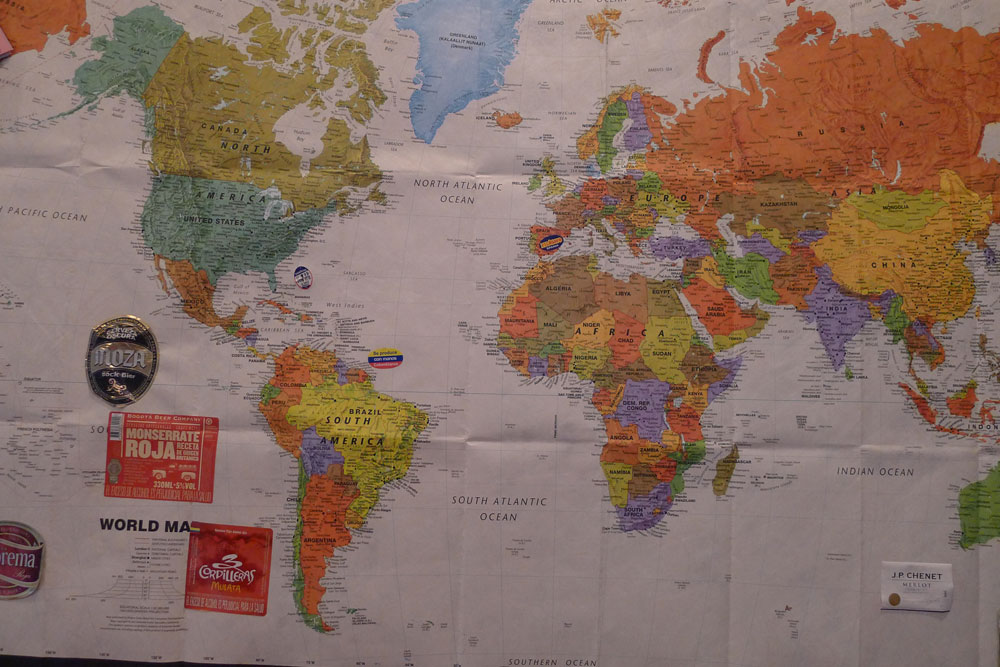 Super poster size tyvek world map is durable and tolerates all of the things we stick on it